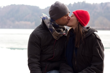 A Sweet Romantic Loving Young Couple Kissing photo