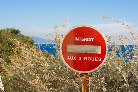 Old No Entry Sign In Front Of A Blue Sky In French