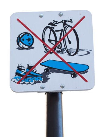 An Isolated Sign Prohibiting Cycling, Rollerbalding, Skateboarding and Ball Playing Stock Photo - 11941177