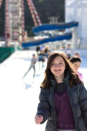 Young Woman Having Fun While Ice Skating photo