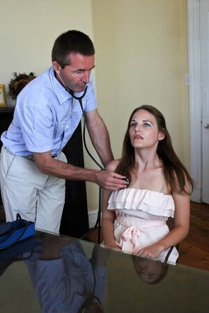 Doctor Doing A Examination of the lungs with a stethoscope In A Private Practice Stock Photo - 13108107