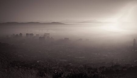 Cape Town On A Misty Morning With Buildings Looking Through The Fog photo
