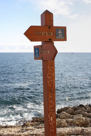 A  Signpost With Water In The Background photo