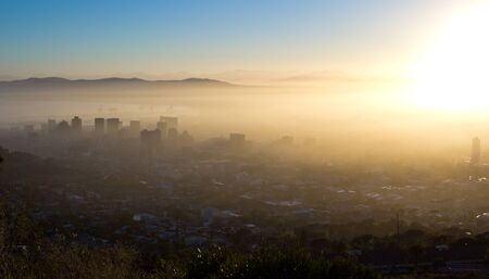 Photo Of Cape Town On A Misty Morning With Buildings Looking Through The Fog photo