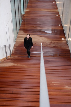 Young Attractive Brunette Woman With Black Clothing Walking Up Stairs photo