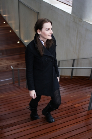 upstairs: Young Attractive Brunette Woman With Black Clothing Walking Up Stairs