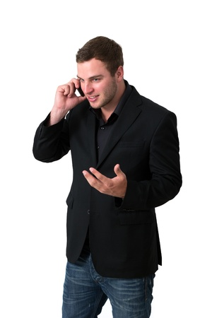 Young Man in jacket talking on the phone and smiling Stock Photo - 13901923