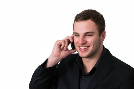 Young Man in jacket talking on the phone and smiling Stock Photo - 13901941