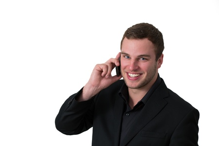 Young Man in jacket talking on the phone and smiling photo