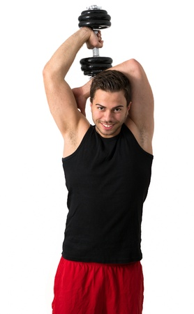 Young attractive man pumping weights in a black tank top photo