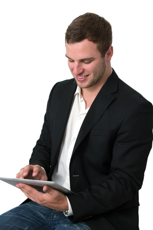 Young Businessman in jeans working on a tablet pc photo