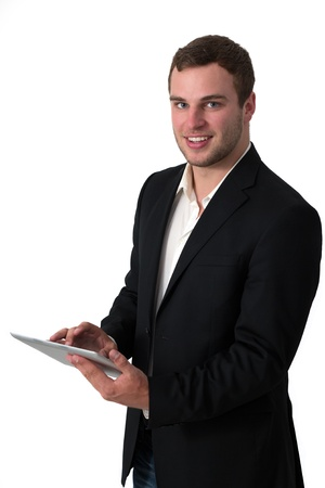 Young Businessman in jeans working on a tablet pc Stock Photo - 14158749