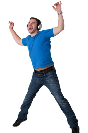 Young Man Listening to music and jumping in the air Stock Photo - 14158736