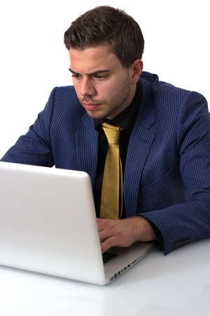 Young Businessman in a Blue suit Working on Hes Notebook photo