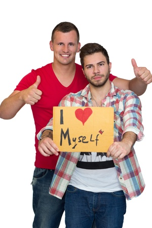 i mate: Two Friends Enjoying Time Together And Holding Sign Saying I Love Myself