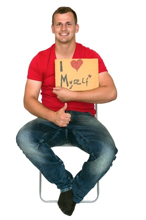 Very happy man with sign saying i love myself Stock Photo - 14748982