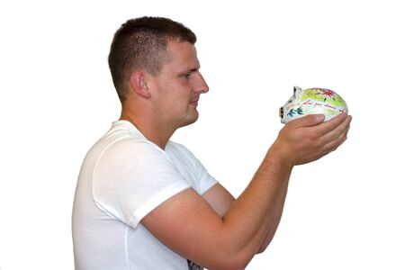 Young Man Holding His Piggy Bank photo