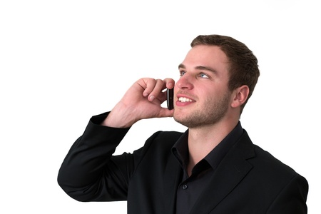 Young Man in jacket talking on the phone and smiling Stock Photo - 14749594