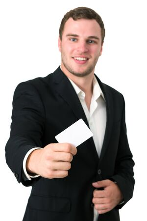 Businessman in a suit giving he's blank business card Stock Photo - 14748973