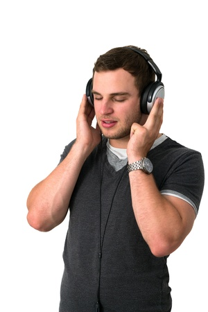 Young man in grey t-shirt listening to music with earphones Stock Photo - 14749638