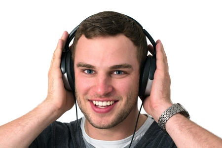 Close up of face of young man in grey t-shirt listening to music with earphones Stock Photo - 14749643