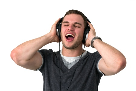 Young man with grey t-shirt Singing with headphones on head Stock Photo - 14749627
