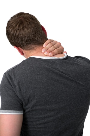 Young man holding his neck in pain Stock Photo - 14749599