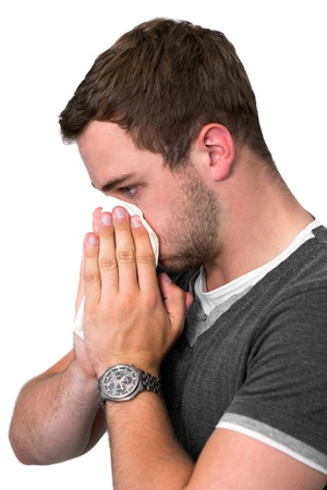 Young Man Blowing Nose into a tissue photo