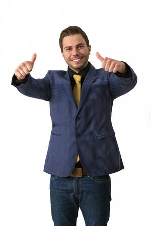 A young sympathetic businessman in a Blue suit with a golden tie doing thumbs up Stock Photo - 14749597