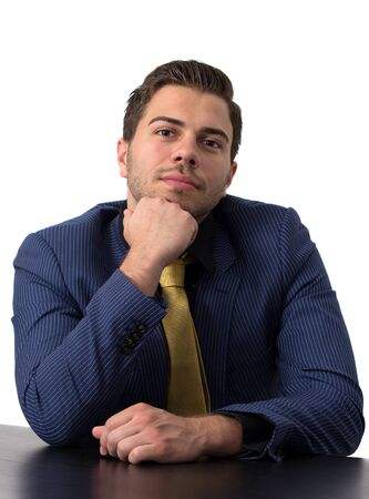 Thoughtful businessman in a blue suit with golden tie Stock Photo - 14749596