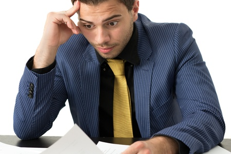 Young stressed overwhelmed businessman wearing a suit and golden tie Stock Photo - 14749652