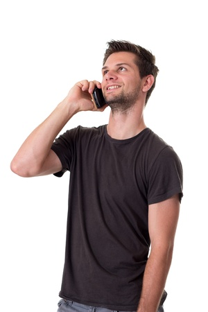 Young Man talking on the phone and smiling photo