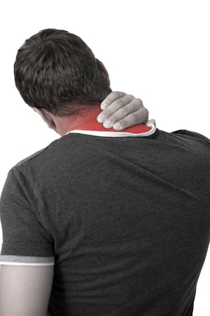 bruised: Young man holding his neck in pain Stock Photo