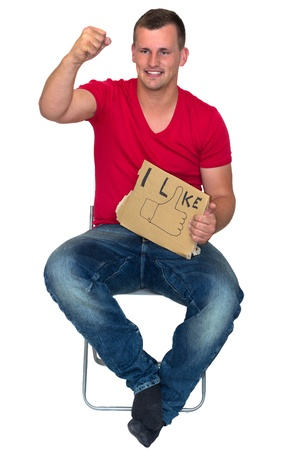 Young Sitting Man with i like sign celebrating joyfully photo