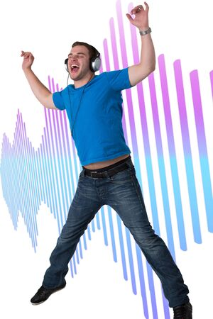 Young Man Listening to music and jumping in the air Stock Photo - 14750937