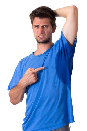 axila: Hombre con hiperhidrosis sudor muy mal debajo de la axila