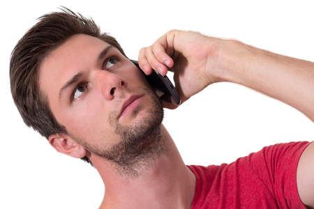 Young Man talking on the phone and looking up Stock Photo - 14750953