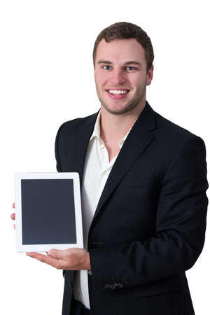 Young white man in suit holding white tablet pc and smiling photo
