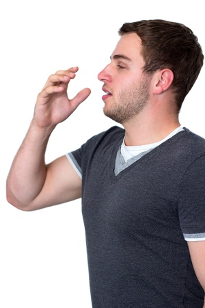 Sick man coughing into he's hand Stock Photo - 14802706