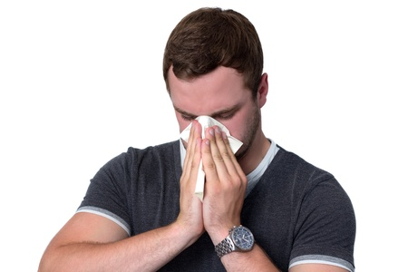 running nose: Young Man Blowing Nose into a tissue