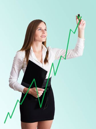 Young Businesswoman in white blouse and black skirt drawing a chart Stock Photo
