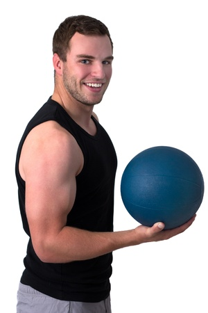 medicine ball: Young attractive fitness coach isolated on white