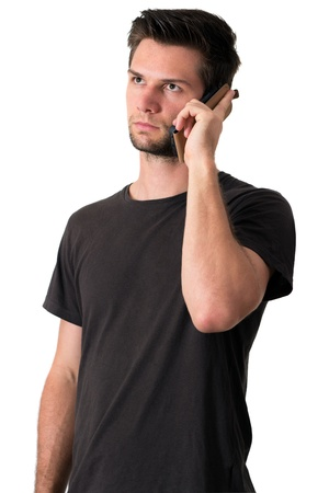 Young Man talking on the phone and smiling Stock Photo - 14929353