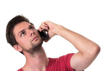 Young Man talking on the phone and looking up photo
