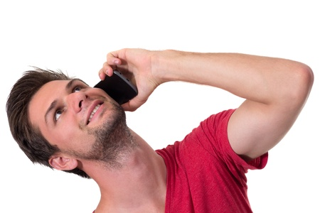 Young Man talking on the phone and looking up Stock Photo - 14928791