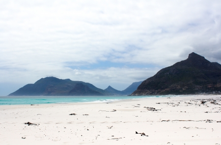 upcoming: Beach of Kommetjie with an upcoming storm in the background and blue water