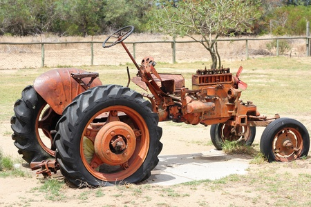 very dirty: Very old red tractor on a farm