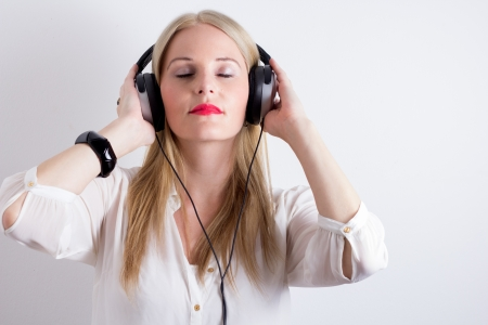 Image of Woman Listening To Music With Headphines Stock Photo - 15127287