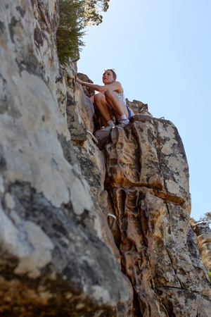 Woman climbing up lions head, cape town, south africa photo