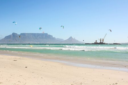 Kiteboarders at Milnerton Beach in Cape Town, South Africa photo